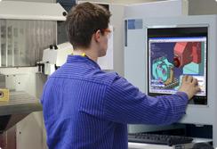 man touching a screen monitor