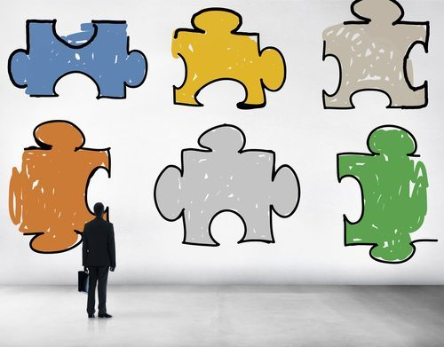 Man Looking at Puzzle Pieces - Work Teamwork Concept