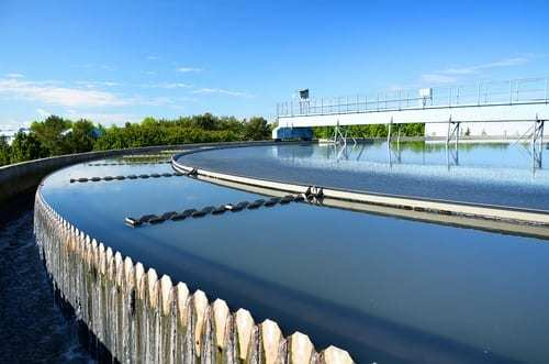 An outdoor photo of a modern urban wastewater treatment plant.